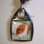 Keyring square sleeping Guinea Pig close